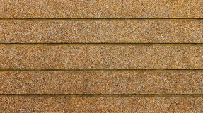 Striped and exposed aggregate on the wall Stock Photography