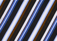Striped fabric. Blue, black, brown and white striped fabric stock photography