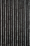 Striped fabric background. Striped black and white satin fabric background stock photography