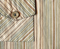 Striped fabric and a pocket on it Royalty Free Stock Photos