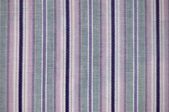 Striped fabric texture. Black and purple striped fabric texture royalty free stock photos