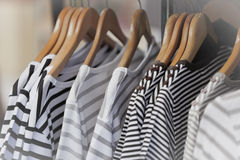 Striped Female Pullovers in a Clothing Store Stock Photography