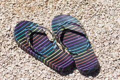 Striped flip flops. On the beach at sunny day stock image