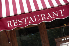 Striped french restaurant canopy in Paris france, menu board. Striped french restaurant canopy in Paris france Royalty Free Stock Photos