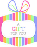 Striped Gift Box. A colorful striped gift box with a ribbon and a label that says A Gift For You Royalty Free Stock Images