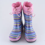 Striped girl's wellington boots Stock Photo