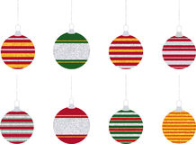 Striped Glitter Christmas Ornaments. Eight red, green, and yellow Christmas ball ornaments decorated with silver and gold glitter stripes in a flat style Royalty Free Stock Photography
