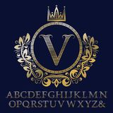 Striped gold letters and initial monogram in coat of arms form with crown. Royal font and elements kit for logo. Design vector illustration