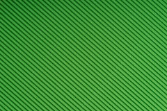 Striped green embossed paper. Colored paper. Verdant texture background. Stock Photo