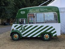 Green Ice Cream Food Truck, Kingston Upon Thames, England, United Kingdom. This striped green food truck sells ice cream and other treats at special events in stock photos