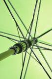 Striped green umbrella Stock Photos