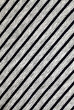 Striped grey and blue cotton fabric background. Diagonal striped grey and blue cotton fabric as a background texture Stock Photos