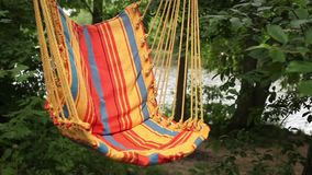 Striped hammock empty. Empty hammock swing on the background of nature stock video footage