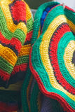 Striped hat. Hand made knitted Rasta caps Royalty Free Stock Photo