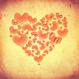 Striped hearts make big heart on beige old paper Royalty Free Stock Photos