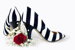 Striped high heels with red rose Stock Photos