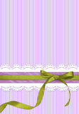 Striped holiday background with green bow stock image
