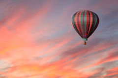 Striped Hot Air Balloon in Pink Sky Stock Photography