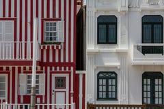 Striped houses in Costa Nova, Portugal. Travel. Stock Photos