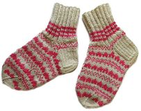 Pair of Two Beige Brown Pink Color Natural Wool Patterned Hand Made Knitted Warm Socks Isolated On White Surface. Woolen Striped Stripe Pattern Style Design Hand royalty free stock photography