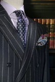 Striped Jacket with Purple Shirt, Tie (Vertical). Mannequin in dark striped double-breasted jacket, purple shirt, patterned black & purple tie and handkerchief royalty free stock photography