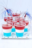 Striped jelly shots with firecracker star Stock Photography