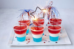 Striped jelly shots with firecracker star Royalty Free Stock Photos
