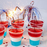 Striped jelly shots with firecracker star Stock Images