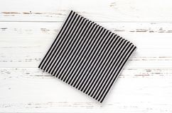 Striped kitchen cloth on white vintage wooden table. copy space.  Stock Photo