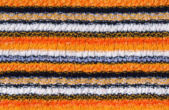 Striped knitted background. In bright colours stock photos