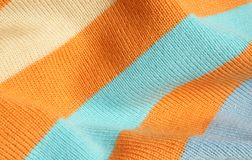 Striped knitted fabric. Background of striped knitted fabric Stock Photos