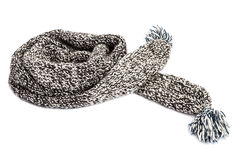 Striped knitted woollen scarf on white background. Royalty Free Stock Images