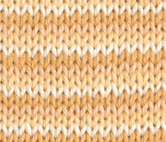 Striped knitting in white and yellow Stock Images