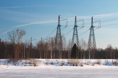 Striped landscape - ice on the river, power line and blue sky Royalty Free Stock Image