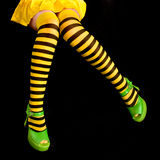 Striped legs. Legs slothed in black and yellow striped tights Royalty Free Stock Photography