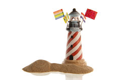 Striped lighthouse, assorted flags, smiley face in Stock Photography