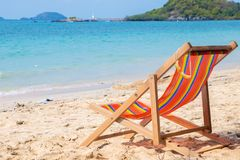 Striped lounger on the blue sea. The concept of relaxation, travel and recreation. Background. There is a place for text. royalty free stock photo