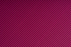 Striped magenta embossed paper. Colored paper. Red wine color texture background. Stock Image
