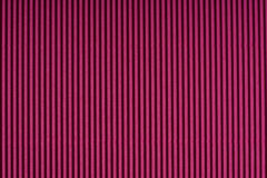 Striped magenta embossed paper. Colored paper. Red wine color texture background. Stock Photo