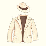 Striped man suit with pockets and hat on a beige background. Outerwear Royalty Free Stock Photos