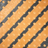 Striped metal background with rivets Royalty Free Stock Photo