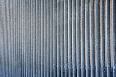 Striped metal vertical rough grated wall.  Stock Photos