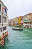 Striped mooring poles in water along the Grand Canal in Venice for boats to navigate and dock. royalty free stock images