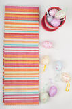 Striped napkin and easter eggs Royalty Free Stock Photos