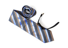 Striped necktie for men with black digital watch on the white ba Stock Photos