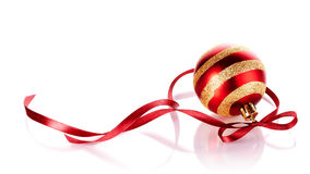 Striped New Years Ball With A Red Tape. Royalty Free Stock Images