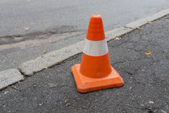 Striped orange cones. On the asphalt road Royalty Free Stock Image