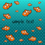Striped orange fish with space for text. Striped orange fish on a blue background with space for text Stock Photography