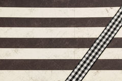 Striped paper with plaid ribbon Stock Images