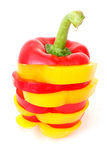 Striped Paprikas. Yellow and red paprika rings photographed on white background Royalty Free Stock Photos